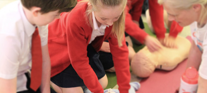 Children learning CPR